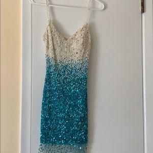 Musani Couture mini cocktail dress.